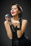 Female singer keeping microphone royalty free stock photography