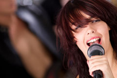 Female singer with microphone Stock Photography