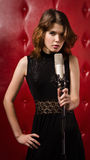 Female singer with microphone Stock Photo
