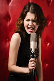 Female singer with microphone Stock Image