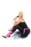 Female singer mith mic sitting Royalty Free Stock Photos