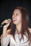 Female singer performing during a Christian concert in the Bronx. BRONX, NEW YORK - MARCH 17: Female singer performs during a Christian concert for Realizing Royalty Free Stock Photos