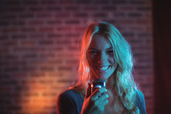 Female singer performing in nightclub. Portrait of female singer performing in nightclub Royalty Free Stock Photography