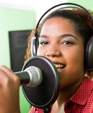 Female Singer Performing In Recording Studio Royalty Free Stock Photography