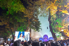 A female singer performing and seen in big screen amongst audience. KOLKATA, WEST BENGAL , INDIA - 9TH MAY 2017 : Female singer performing and seen in a giant Stock Images