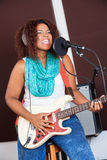 Female Singer Playing Guitar In Recording Studio Royalty Free Stock Images