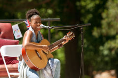 Female Singer Plays Guitar And Sings At Festival Stock Photos