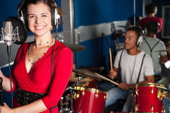 Female singer recording a track in studio Stock Photography