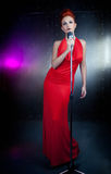 Female singer red dress Royalty Free Stock Photos