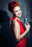 Female singer red dress Stock Photography