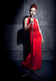Female singer red dress Stock Image