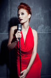 Female singer red dress Royalty Free Stock Image
