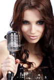 Female singer with the retro mic Stock Photos