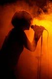 Female singer silhouette Stock Images