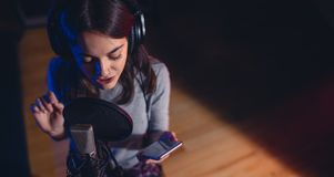 Female singer singing song in recording studio Royalty Free Stock Photos