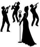 Female  singer on stage in silhouette. Female  singer on stage with backup band in silhouette Royalty Free Stock Photos