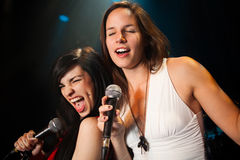Female singers performing a duet Royalty Free Stock Photography