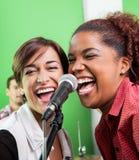 Female Singers Performing In Recording Studio Royalty Free Stock Image