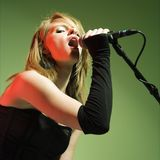 Female singing. Royalty Free Stock Photography