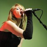 Female singing. royalty free stock photography