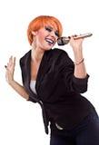 Female singing into mic stock photo