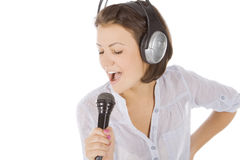 Female singing into microphone. Royalty Free Stock Images