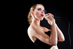 Female singing into microphone Royalty Free Stock Photos