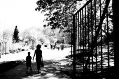 Female Single parent mother takes a walk with her child while others have fun Royalty Free Stock Images