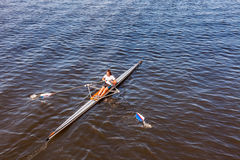 Female single scull rowing competitor. Stock Images
