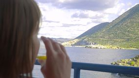 Female sitting the balcony of hotel and looking to lagoon sea stock video