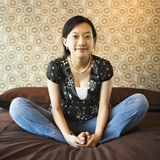 Female sitting on bed. Royalty Free Stock Photos