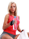 Female sitting with bottle of water in hands Royalty Free Stock Photo