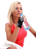female sitting with bottle of water in hands Stock Photography