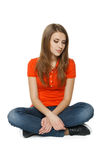 Female sitting on the floor Royalty Free Stock Photos