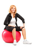 Female sitting on a pilates ball Stock Photography
