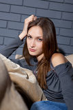 Female sitting on sofa Royalty Free Stock Images