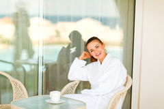 Female sitting on terrace with cup of coffe Stock Images
