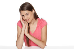Female sitting at white table Royalty Free Stock Photography