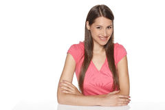 Female sitting at white table Stock Image