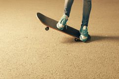 Female on skateboard legs and a lot of copyspace Royalty Free Stock Images