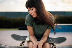 Female skateboarded relaxing at skate park Royalty Free Stock Photos