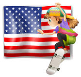 A female skater near the USA flag Stock Photo