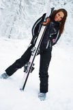 Female skier. Young smiling woman with skis and mask standing Stock Images