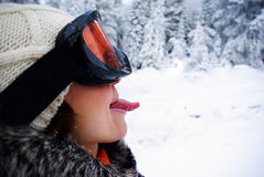 Female skier. Happy female skier showing her tongue Royalty Free Stock Image
