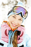 Female skier. Portrait of a happy young female skier Stock Images