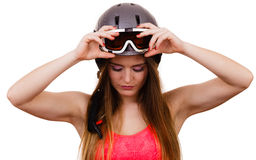 Female skier adjusting helmet. Royalty Free Stock Photos