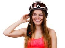 Female skier adjusting helmet. Stock Image