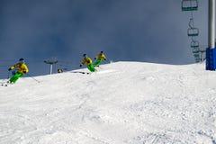 Female skier carving down an Australian ski slope Royalty Free Stock Image