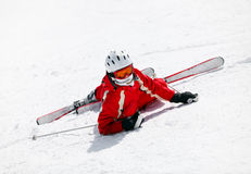 Female skier after falling down on mountain slope stock photos