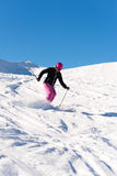 Female skier in fresh powder snow. Action shot of a female sportive middle aged skier in fresh powder snow Royalty Free Stock Photos
